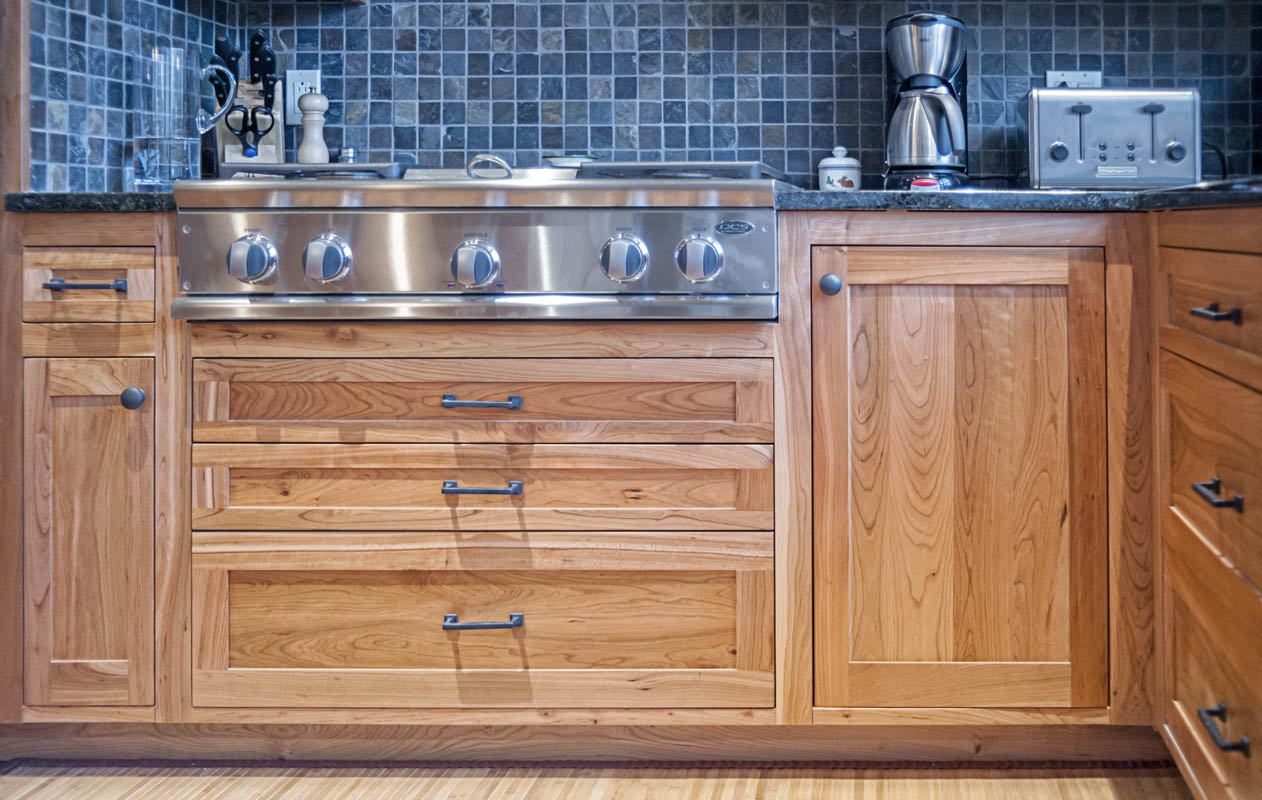 Shaker Style Custom Kitchen Cabinets - lower cabinets around the stove