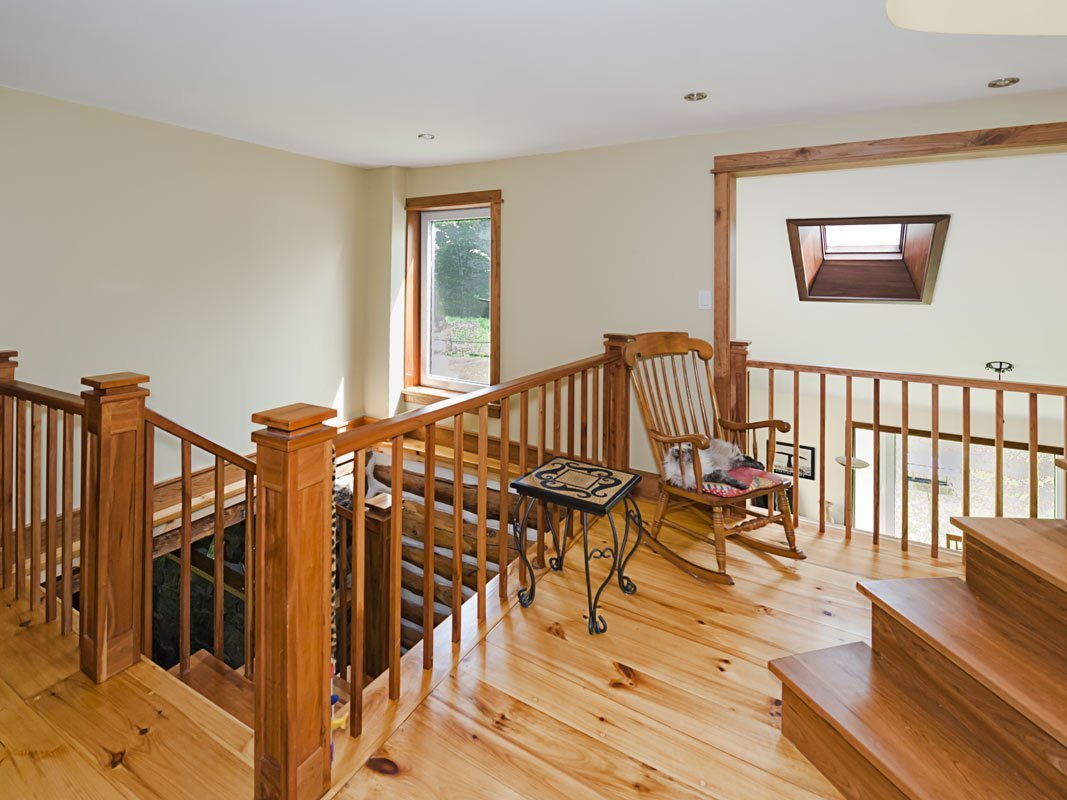 Mezzanine and Staircase Handrails with Newel Posts in Cherry